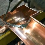 soldering-copper-gutter-twincitiesremodeler-1466x977