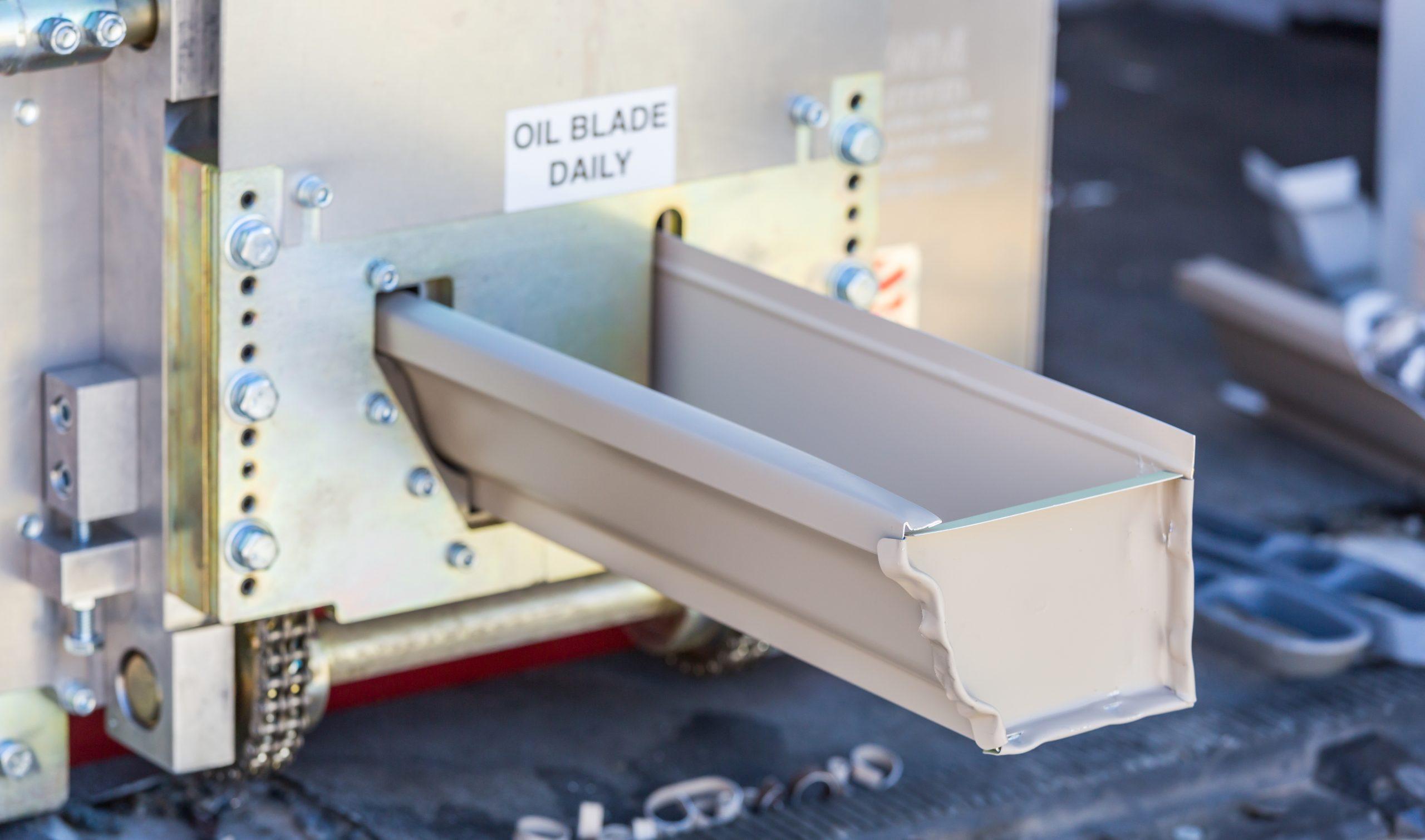Kodiak DGS TX, Aluminum Rain Gutter Feeding Through Seamless Shaping Machine