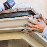 Kodiak DGS Repairing and Attaching Aluminum Rain Gutter to Fascia of House.